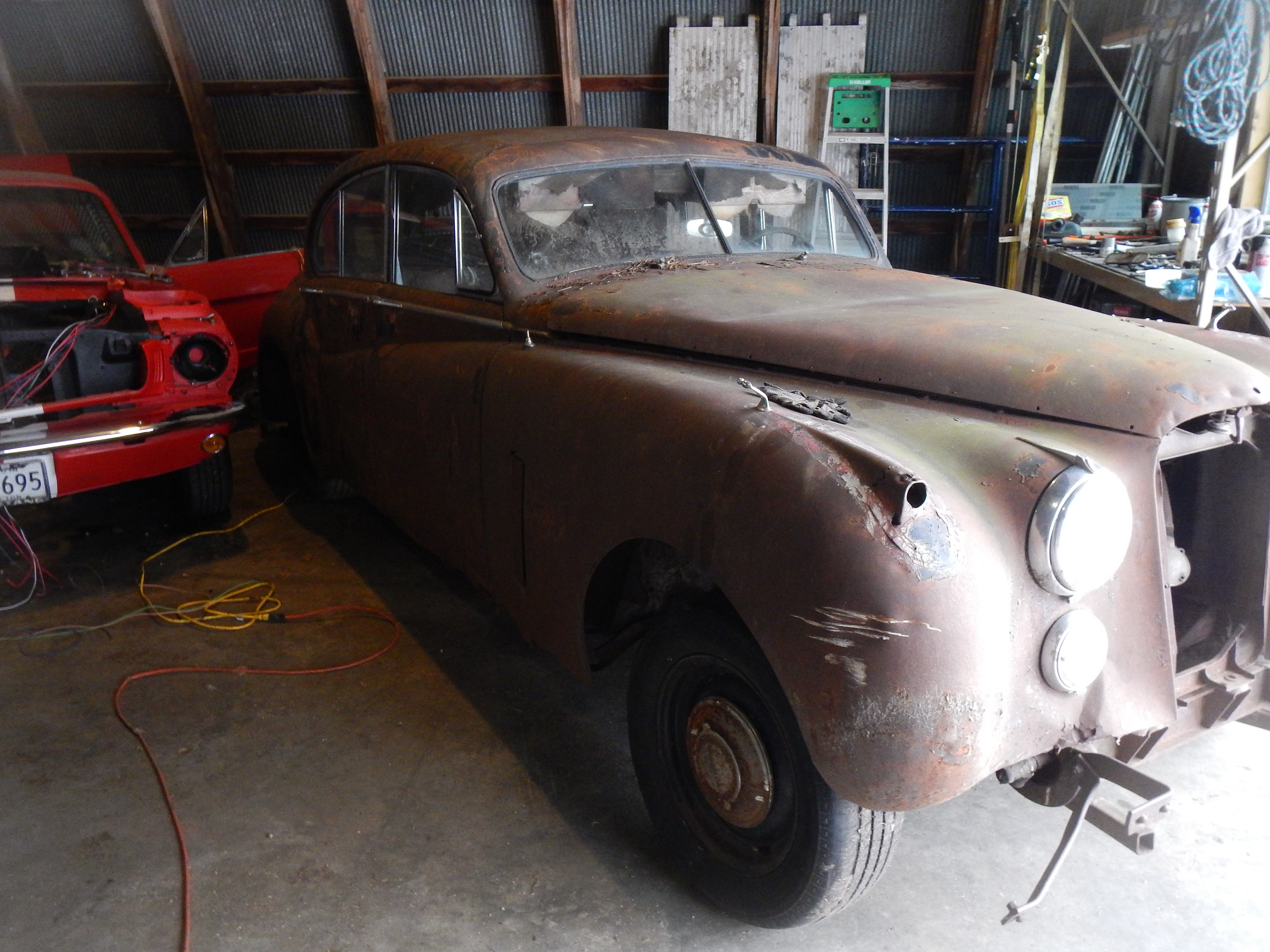 Jaguar Mark Vii Convertable Antique Car Wire Harness In Its New Home Out Of The Weather Waiting For More Attention Sitting Beside A Mustang Getting