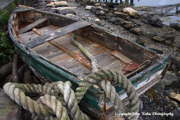 Dilapidated Dinghy and Rope